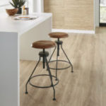 Horizen Flooring presents to you a picture of a 12mm Laminate flooring with click lock system, manufactured by EagleCreek Floors. Color: Oak Fano.