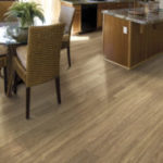 Horizen Flooring presents to you a picture of a 12mm Laminate flooring with click lock system, manufactured by EagleCreek Floors. Color: Valencia Hickory.