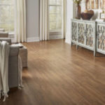 Horizen Flooring presents to you a picture of a 12mm Laminate flooring with click lock system, manufactured by EagleCreek Floors. Color: Oak Paloma.