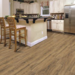 Horizen Flooring presents to you a picture of a 12mm Laminate flooring with click lock system, manufactured by EagleCreek Floors. Color: Walnut Malawi.