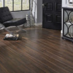 Horizen Flooring presents to you a picture of a 12mm Laminate flooring with click lock system, manufactured by EagleCreek Floors. Color: Walnut Morningside.