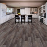 Horizen Flooring presents to you a picture of a luxury vinyl plank flooring, manufactured by Eagle Creek Floors in the Syncorex collection. Color: Heatherstone