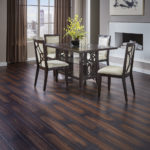 Horizen Flooring presents to you a picture of a luxury vinyl plank flooring, manufactured by Eagle Creek Floors in the Syncorex collection. Color: Montgomery Maple