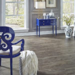 Horizen Flooring presents to you a picture of a luxury vinyl plank flooring, manufactured by Eagle Creek Floors in the Syncorex collection. Color: Hickory Firethorn