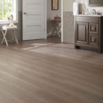 Horizen Flooring presents to you a picture of a hickory wide plank hardwood flooring, manufactured by Eagle Creek Floors. Color: Hickory Grey