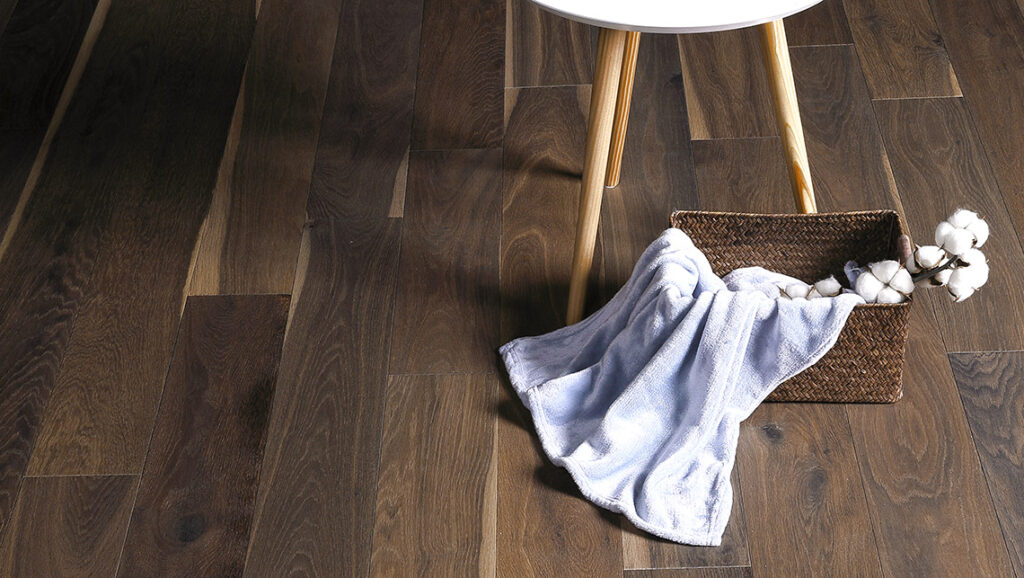 "Horizen Flooring presents to you a picture of a quality 6"" wide plank French Oak hardwood flooring, manufactured by Aayers Flooring. Color: Ironwood. Incorporated in Kent Washington in 2012, AAYERS Flooring has been producing quality lumbers and world class floorings since 2000 through its Holding company. AAYERS Flooring inherited expertise in producing stylish and quality solid and engineered hardwood floors, and all of its our products have been very well accepted in the market. Taking pride in using quality materials, state-of-the-art equipment and exacting safety and quality control measures to ensure that every customer receives the highest quality product, AAYERS Flooring is committed to redefining the look of floors and beautifying interior spaces, offering product value, sustainable flooring solutions and incredible style options."