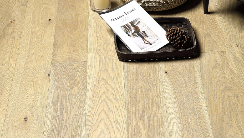 "Horizen Flooring presents to you a picture of a quality 6"" wide plank French Oak hardwood flooring, manufactured by Aayers Flooring. Color: Willow. Incorporated in Kent Washington in 2012, AAYERS Flooring has been producing quality lumbers and world class floorings since 2000 through its Holding company. AAYERS Flooring inherited expertise in producing stylish and quality solid and engineered hardwood floors, and all of its our products have been very well accepted in the market. Taking pride in using quality materials, state-of-the-art equipment and exacting safety and quality control measures to ensure that every customer receives the highest quality product, AAYERS Flooring is committed to redefining the look of floors and beautifying interior spaces, offering product value, sustainable flooring solutions and incredible style options."