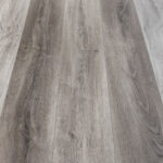 """Horizen Flooring presents to you a picture of a quality 7"""" wide plank luxury vinyl SPC flooring. LW Flooring is widely reknowned for it's German adhesive and state of the art technology. Color Presented: Moonstone Creek - Riverstone Collection."""